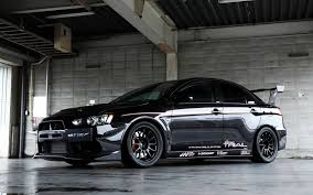 mitsubishi lancer modified black mitsubishi lancer evo x in the garage wallpapers and images