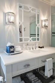 small bathroom with white cabinets under two white sinks white