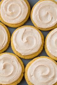 Halloween Pumpkin Sugar Cookies - pumpkin sugar cookies with cinnamon cream cheese frosting