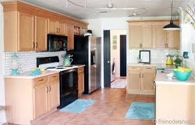 country living 500 kitchen ideas 13 ways to upgrade your builder grade cabinets without replacing