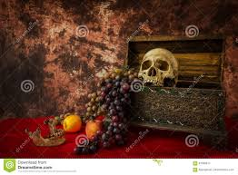 still life with a human skull with fake apples and grapes stock