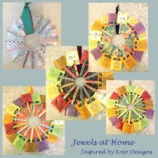 scrapbook paper clothespin wreaths inspired by kojo designs