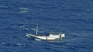 boat carrying suspected people smugglers and chinese men landed on