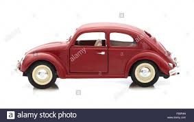 red volkswagen beetle vw beetle in red die cast model on a white background stock photo