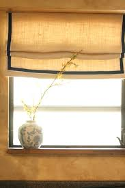 faux roman shade made from burlap and dropcloth trimmed in ribbon
