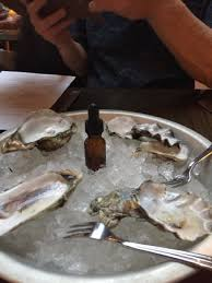 mignonette cuisine oysters with mignonette in a dropper picture of the grey