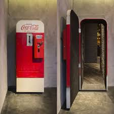 vintage coca cola vending machine door opens to a secret bar in vintage coca cola vending machine door opens to a secret bar in unique speakeasy themed entrance with camouflage