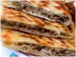 recettes de cuisines recette syrienne pains farcis à la viande zeinelle magazine