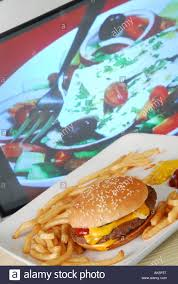 programme tv cuisine concept to unhealthy fast food tv dinner in front of