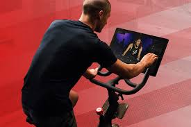 spinning cycling house the peloton bike brings the beautiful hell of spin class to your