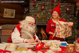 photo santa writing letter with postal elf in santa claus main