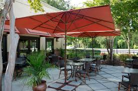 outdoor large square white lowes patio umbrella with brown dining