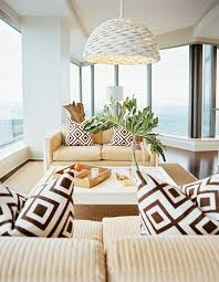 design a living room in tropical style with bay window for small