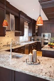 Kitchen With Brown Cabinets Giallo Ornamental Granite Countertops Add Elegance In The Kitchen