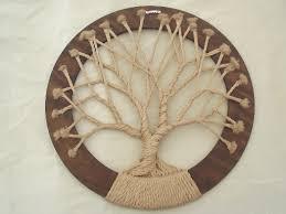 of hippie vintage macrame wall hanging in circle frame