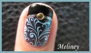 black french tip manicure with gold shell accent konad stamping