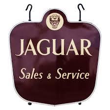 rare vintage jaguar sales and service porcelain dealership sign at