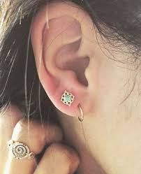 second ear piercing earrings the 10 coolest piercing combos that look on everyone ear