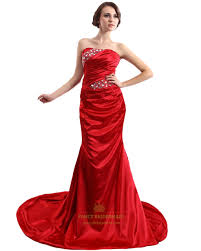 red mermaid strapless prom dress with ruched bust and beading