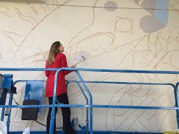 public art ola volo creates new mural for south granville mural artist ola volo south granville vancouver photo