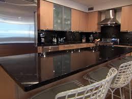 butcher block countertops kitchens with black lighting flooring