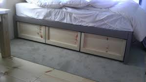white daybed with storage diy platform open underneath for basket