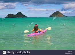 hawaii oahu lanikai back view of woman in pink kayak clear