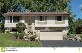 tan split level house with lower garage stock photo image 77166611