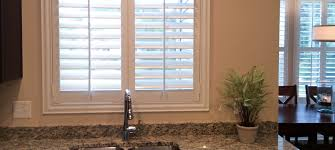 plantation shutters over a sink window taylor shutters