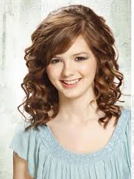 medium length curly hairstyles with bangs shoulder length curly