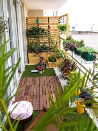 add a playful pallet wall to your balcony space to house your wall plants