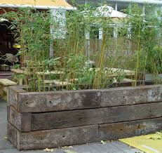how to build a raised bed with railway sleepers garden and