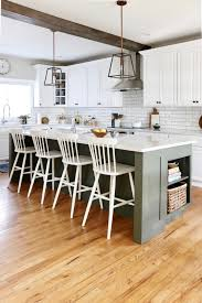 white kitchen cabinets with wood beams earthy coastal white kitchen reveal