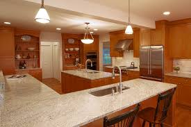 maple cabinets with white countertops kashmir white granite kitchen traditional with maple cabinets ge