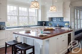 blue kitchen backsplash white kitchen cabinets with blue subway tiles transitional kitchen