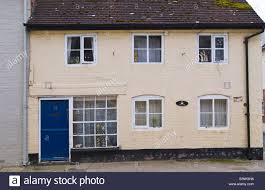 blue front door of terraced cottage in ludlow shropshire england
