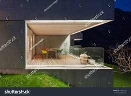 house porch at night architecture modern design concrete house lit stock photo