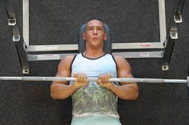 la fitness member bryant performing a close grip bench press 3