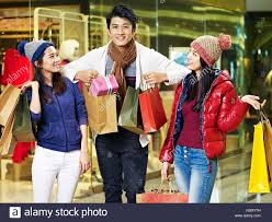 young asian people friends enjoying shopping for christmas gifts