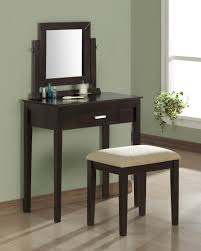 black makeup vanity table with lighted mirror on atop and chair