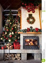 christmas cozy interior of fireplace and christmas tree stock