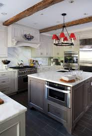 kitchen island with microwave drawer driftwood stained cabinetry kitchen traditional with grey country