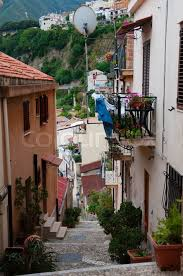 narrow street and stairs between cute italian houses in old town