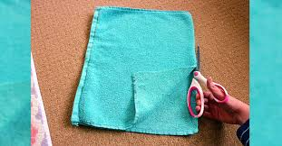 she cuts into an old bath towel the end result i need to make one