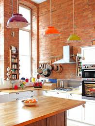 wooden island white cabinets purple orange green pendant lights