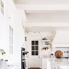 see the bright custom designed kitchen of a fashion blogger