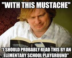 Guy With Mustache Meme - a curious male reads fifty shades of grey