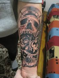 skull with a clock and flowers skull tattoos