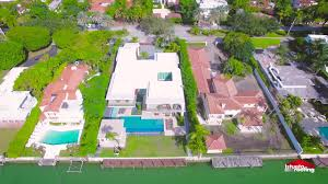 white flat roof and waterproofing for waterfront home in miami