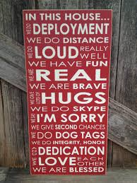 military sign in this house we do deployment subway art